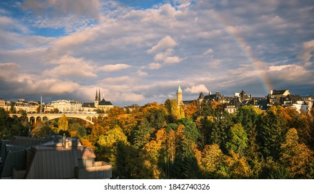 Luxembourg city in autumn and rainbow ,city view   scene with the main cathedral and Adolf Bridge the city park in the foreground.