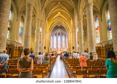 Luxembourg City, Luxembourg - July, 12, 2015 : People during mass in catholic Church, Luxembourg City on July, 12, 2015
