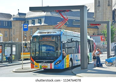 LUXEMBOURG CITY, LUXEMBOURG - JULY 7, 2018 - Volvo 7900 electric hybrid city bus at the pantograph charging station by the Luxembourg Central railway station