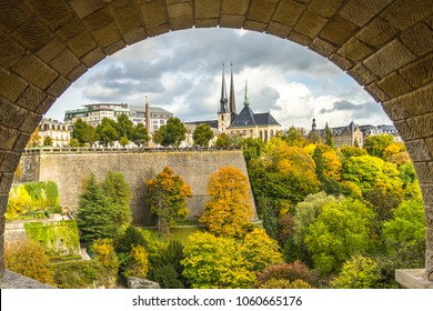 Luxembourg city, Luxembourg - October 12 2017: The view of iconic Gelle Fra and Notre-Dame cathedral in fall from the pedestrian walk under Adolphe bridge in Luxembourg.