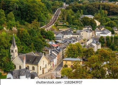 Luxembourg City, Luxembourg: September 15, 2018 - The view from Grand Duchess Charlotte Bridge down into the Pfaffenthal valley and along Rue Vauban