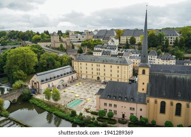 Luxembourg City, Luxembourg - September 24 2019: Neimenster Cultural Center and Church of Saint John in Grund beside the Alzette River as seen from Chemin de la Corniche Fortified Wall