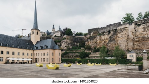 Luxembourg City,Luxembourg - May 19, 2019: Panorama of Old Town square in Luxembourg, Bock Casemates, a vast complex of underground tunnels & galleries used as WWII bomb shelters, on the background.