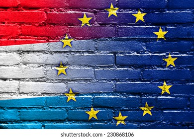 Luxembourg and European Union Flag painted on brick wall