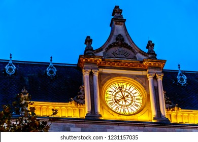 Luxembourg / Luxemburg - Sept. 20, 2018: The lighted clock of Cercle Cité Luxembourg at night in the heart of the city of Luxembourg