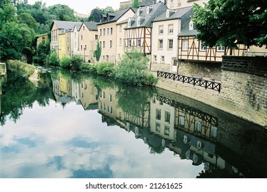 Luxembourg old houses near river cityscape reflection