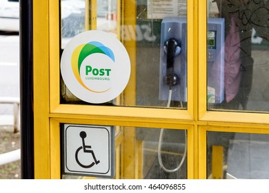 LUXEMBOURG, LUXEMBOURG - Post Luxembourg sticker on yellow phone boothe in the center of Luxembourg. Former Entreprise des Postes et Telecommunications, branded as POST Luxembourg and  to POST