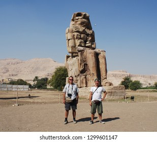 LUXOR EGYPT 11 21 2008:  The Colossi of Memnon  two massive stone statues of Pharaoh Amenhotep III