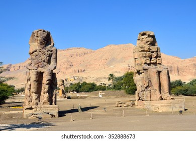 LUXOR, EGYPT - DECEMBER 3 2015: Colossi of Memnon are two gigantic stone statues of Amenhotep III that were built in the fourteenth century BC in front of the mortuary temple of Amenhotep III.