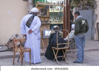 Luxor, Egypt - December 30, 2006: People on the street watching on TV the execution of Saddam Hussein.