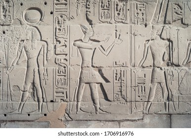 Luxor, Egypt - December 30 2010: Bas-Relief of Pharaoh Ramesses II delivering Maat Sacrifice to God Amun Ra, Exterior Wall of Karnak Temple.