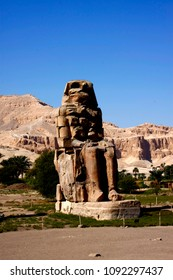 Luxor Egypt Entrance to the city of Luxor Pharaonic statue of the old Mannoun