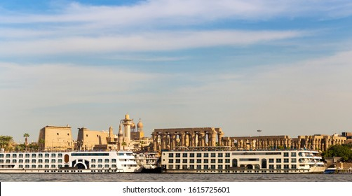Luxor, Egypt, Karnak Temple, complex of Amun-Re. View of the ancient city of Thebes from the Nile. Panoramic city, view from the river.
