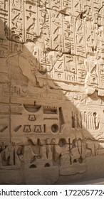 Luxor Egypt Karnak temple sandstone craved hieroglphic wall and column pharoah and anceint story