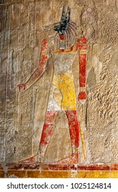 LUXOR, EGYPT - MAY 05, 2013 : An engraved relief  depicting Anubis the canine god of the dead at the Mortuary Temple of Hatshepsut at Deir al-Bahari near Luxor in central Egypt.