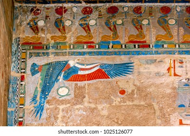 LUXOR, EGYPT - MAY 05, 2013 : One of the spectacular reliefs at the Mortuary Temple of Hatshepsut at Deir al-Bahri near Luxor in Egypt. The bird like figure represents goddess Nekhbet.