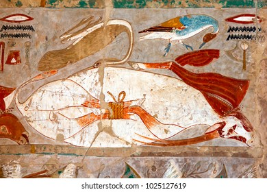 LUXOR, EGYPT - MAY 05, 2013 : An engraved relief picturing various birds and an animal tied by the legs at the Mortuary Temple of Hatshepsut at Deir al-Bahari at Luxor in Egypt.