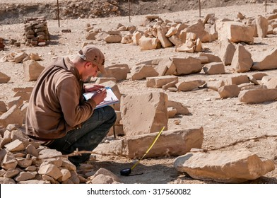 LUXOR, EGYPT - NOVEMBER 26, 2011: Archaeologists working near the Mortuary Temple of Queen Hatshepsut, located on the west bank of the Nile near the Valley of the Kings in Egypt.