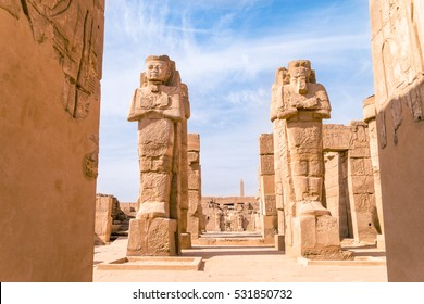 LUXOR, EGYPT - NOVEMBER 29, 2016: Ancient ruins of Karnak temple in Egypt at noon. The complex is a vast open-air museum, and the second largest ancient religious site in the world