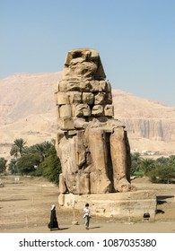 LUXOR, EGYPT-JAN. 9, 2009:  One of the two Statues of the Pharaoh Amenhotep III known as the Colossus of Memnon.