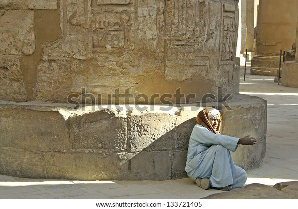 LUXOR, KARNAK, THEBES, EGYPT - JANUARY 13: Waiting for tourists on January 13, 2006 in Karnak temple complex in Egypt. Tourism is an important item in the Egyptian economy.