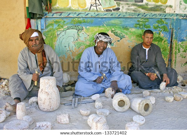 LUXOR, THEBES, EGYPT - JANUARY 13: Workers in a Alabaster vases Manufacturers showing their work to tourists on January 13, 2006 in Luxor, Thebes. Tourism is an important item in the Egyptian economy.