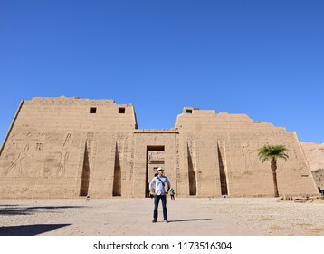 Luxor/Egypt - 10/10/2016 - Holiday Background for tourist wearing a hat  infront of  Ancient pharaonic temple in Luxor Egypt