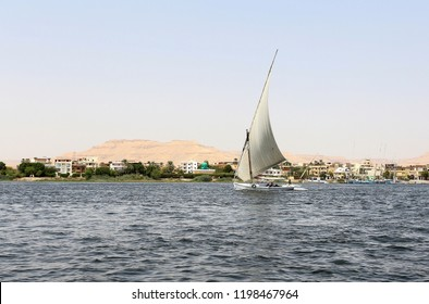 Luxor,Egypt,09.07.2018.A traditional wooden sailing boat or felucca on the river Nile.This vehicle is still very popular among tourists.