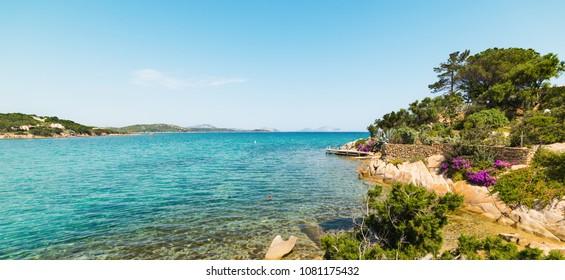 luxuriant vegetation and turquoise sea in Cala Girgolu
