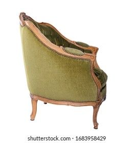 Luxurious, antique green armchair on a white, isolated background. Old, palace furniture. Side view.