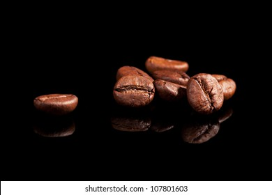 Luxurious aromatic coffee beans on black background. Luxurious coffee concept.