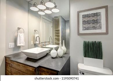 Luxurious bathroom interior boasts modern dark grey vanity cabinet.