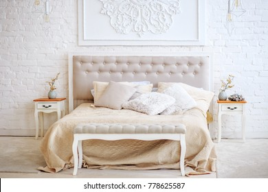 Luxurious bedroom with bed and bedside tables. Concept interior, home, comfort, hotel.