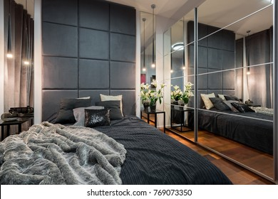 Luxurious bedroom with double bed and mirrored wardrobe