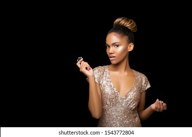 Luxurious Black Afro American Girl with a perfect hairstyle and bright make-up is posing with casino chips in her hands. Casino, Poker and Roulette. Gambling dark-skinned Woman Lucky with perfect card