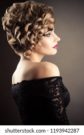 luxurious blond woman with beautiful ringlets curls