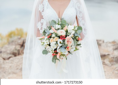 luxurious bouquet in the hands of the bride in a wedding dress