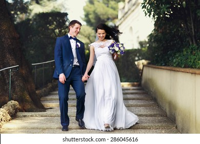 luxurious bride and groom walking spring park of tivoli italy