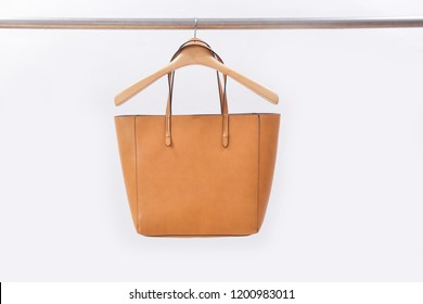 Luxurious brown leather bag on hanger