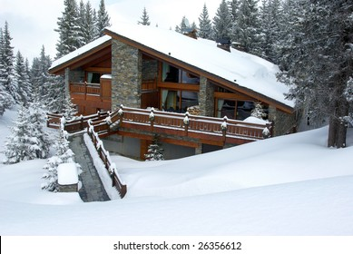 Luxurious chalet covered with snow in a skiing resort.