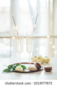 Luxurious champagne wedding party with white roses and macaron d