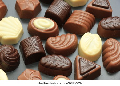 Luxurious chocolates in various shapes and colors