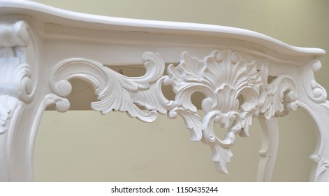 Luxurious classic handmade furniture, white carved elements. Barocco, rococo, vintage style.