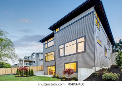Luxurious contemporary three-story wood siding home exterior in Bellevue. Northwest, USA