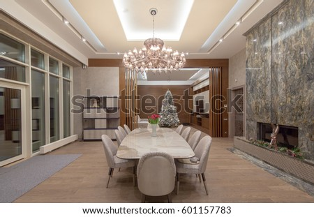 Luxurious Dining Room With A Large Table Chairs Crystal Chandelier And Fireplace