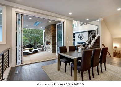 Luxurious dining room with view of outdoor living area.