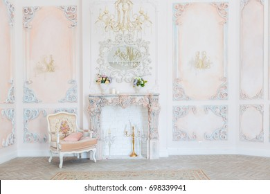 Luxurious expensive interior design of the living room in the old Baroque style in beige colors