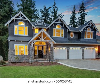 Luxurious Home Exterior With Grey Vinyl Siding And White Trim, Three  Attached Garage Spaces.