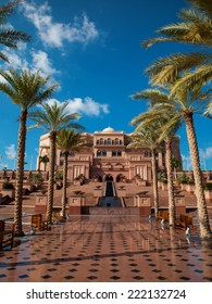 Luxurious Hotel - Emirates Palace - at the center of Abu Dhabi (Capital of UAE). Palm alley and stairs in front of the building.