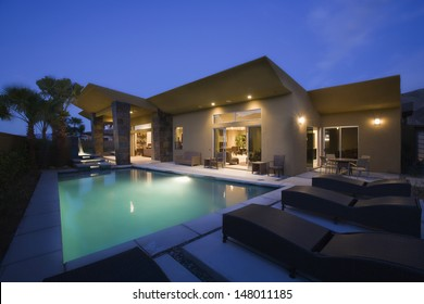 Luxurious house with swimming pool at night